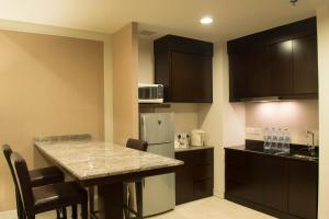 A kitchen or kitchenette at Grands I Hotel