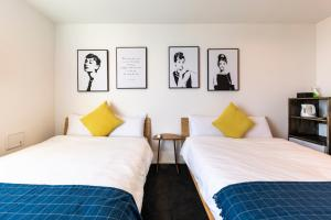 A bed or beds in a room at Theatel Haneda