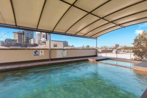 The swimming pool at or near Bright Central Pad with Rooftop Pool, Gym & Parking