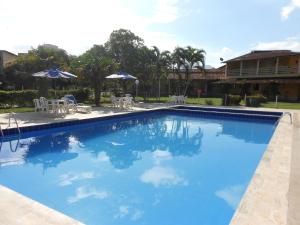 The swimming pool at or near Hotel Pousada Caminho da Praia