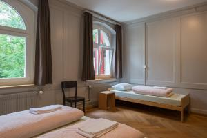 A bed or beds in a room at Schaffhausen Youth Hostel