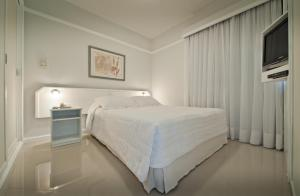 A bed or beds in a room at Ninety Hotel