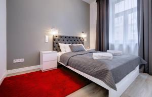 Łóżko lub łóżka w pokoju w obiekcie Zamkowa15 Apartments