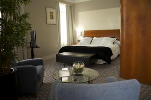 A bed or beds in a room at Gran Hotel Albacete