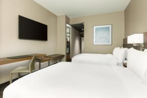 A bed or beds in a room at AC Hotel by Marriott New York Times Square