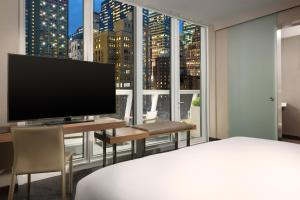 A television and/or entertainment centre at AC Hotel by Marriott New York Times Square