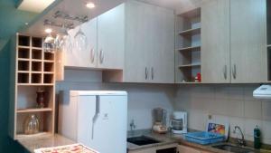 Una cocina o zona de cocina en Fullfloripa Flats