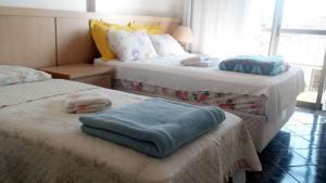Cama o camas de una habitación en Fullfloripa Flats