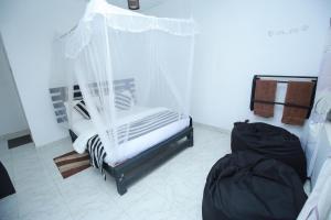 Ein Bett oder Betten in einem Zimmer der Unterkunft Rawana Fall View Guest House