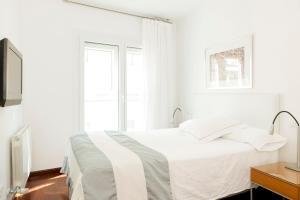 A bed or beds in a room at Apartamentos Sabinas El Pilar