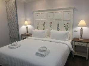 Ein Bett oder Betten in einem Zimmer der Unterkunft Marquise Boutique Hotel