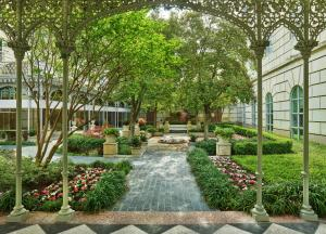 A garden outside Hotel Crescent Court