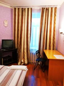 Телевизор и/или развлекательный центр в Комнаты Антресоль