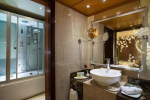 A bathroom at M/S Esmeralda Nile Cruise - 4 or 7 Nights From Luxor each Monday and 03 Nights From Aswan each Friday
