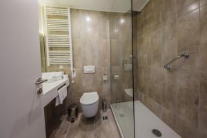 Een badkamer bij Hotel Medena