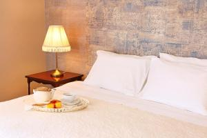 A bed or beds in a room at Eugaria Country House by Lost Lisbon
