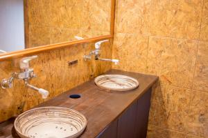A bathroom at Guesthouse Kakehashi
