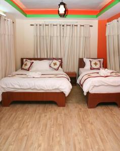 A bed or beds in a room at Thamel Backpackers Home