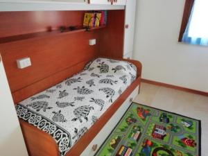 A bed or beds in a room at Apartment The Sea of Sardinia