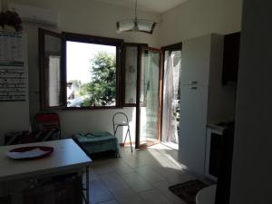 A seating area at Apartment The Sea of Sardinia