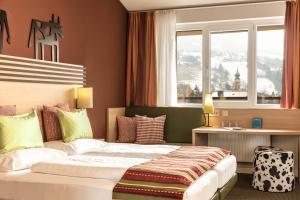 Ein Bett oder Betten in einem Zimmer der Unterkunft TUI BLUE Schladming