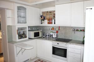 A kitchen or kitchenette at Exclusive Apartment in Glyfada Centre, 1' to Beach