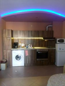 A kitchen or kitchenette at Private Apartment in Sunny House family