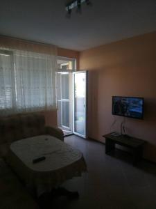 A television and/or entertainment center at Private Apartment in Sunny House family