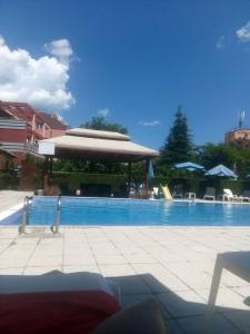 The swimming pool at or near Private Apartment in Sunny House family