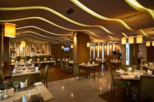 A restaurant or other place to eat at Adarsh Hamilton