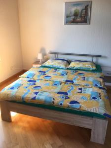 Ein Bett oder Betten in einem Zimmer der Unterkunft Apartment Perim