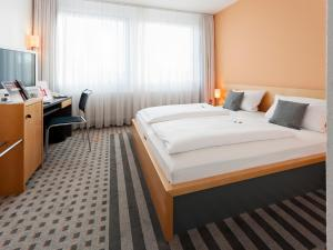 Ein Bett oder Betten in einem Zimmer der Unterkunft Best Western Hotel am Europaplatz
