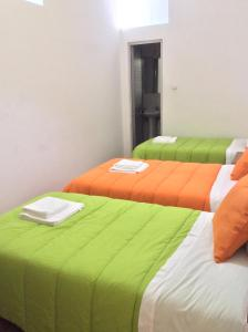 A bed or beds in a room at Alojamento Local Duarte's