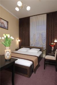 Кровать или кровати в номере Елисеефф Арбат Отель