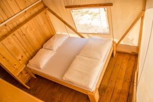 A bed or beds in a room at Sunflower Camping