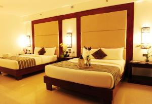 A bed or beds in a room at Boracay Summer Palace Hotel