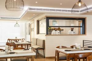 A restaurant or other place to eat at Ginger Mumbai, Andheri