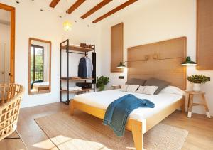 A bed or beds in a room at Casa Vaganto