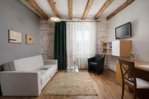 Ein Sitzbereich in der Unterkunft Hotel La Grisa