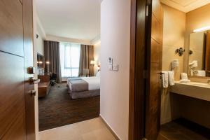 Salle de bains dans l'établissement Citea Apart Hotel