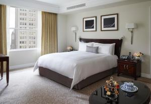 A bed or beds in a room at The Peninsula New York