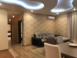Гостиная зона в Apartment Vanilnoe Nebo