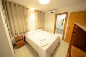 Cama ou camas em um quarto em Pousada Ana do Forte