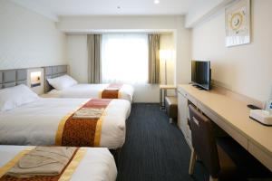 A television and/or entertainment center at Day Nice Hotel Tokyo