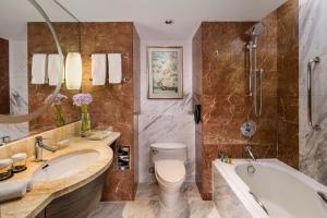 A bathroom at The Kunlun Jing An
