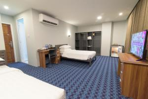 Casa Yangon Hotelにあるベッド
