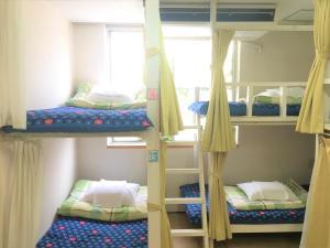Tempat tidur susun dalam kamar di Kagoshima Little Asia