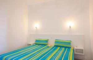 A bed or beds in a room at Sunny Village