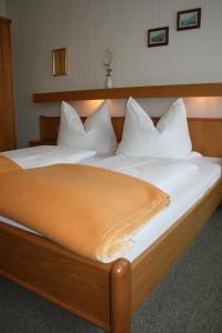 Ein Bett oder Betten in einem Zimmer der Unterkunft Gasthof Grünling