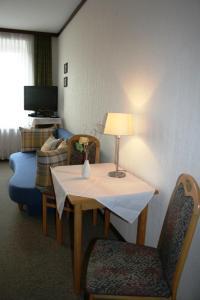 Ein Sitzbereich in der Unterkunft Gasthof Grünling